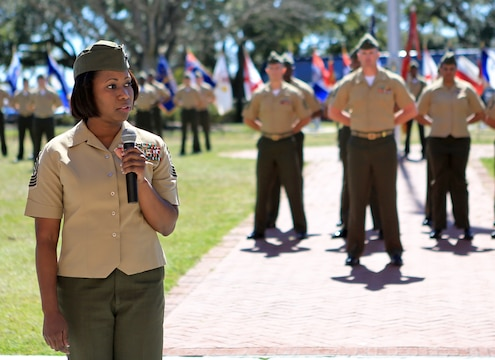 Sgt. Maj. Lanette N. Wright speaks to family, friends and fellow Marines after being appointed as the 24th Marine Expeditionary Unit sergeant major aboard Camp Lejeune, N.C., March 14, 2014. Wright, a Boca Raton, Fla., native, is the first female MEU sergeant major in Marine Corps history.