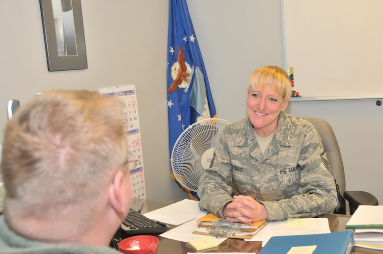STRATTON AIR NATIONAL GUARD BASE, N.Y. -- Master Sgt. Melissa Straus, 109th Medical Group first sergeant, talks to an Airman on March 10, 2014. As the first sergeant she is responsible for the welfare, morale, career progression, professional development, discipline and recognition of the Airmen in the Medical Group. (Air National Guard photo by Tech. Sgt. Catharine Schmidt/Released)