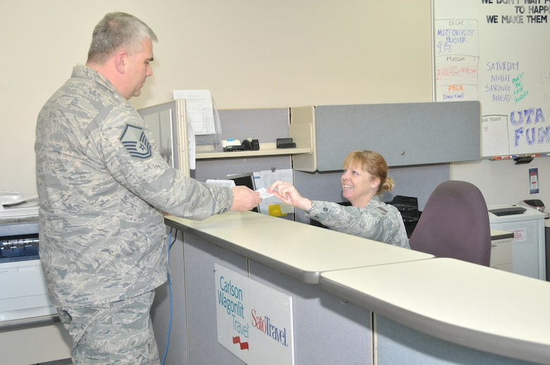 STRATTON AIR NATIONAL GUARD BASE, N.Y. -- Senior Master Sgt. Deborah Gardner gives out information to a Transportation Management Office customer March 9, 2014. Gardner has been filling the additional duty of ticketing for 109th Airlift Wing travelers. Her primary position is with vehicle management and analysis with the 109th Logistics Readiness Squadron's Vehicle Maitenance Flight. (Air National Guard photo by Tech. Sgt. Catharine Schmidt/Released)