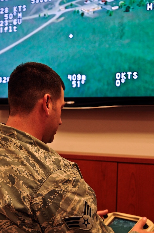 Senior Airman Andrew Goffeney, 1st Special Operations Security Forces Squadron combat arms journeyman, practices using a small unmanned aerial system simulator in a unit training room at Hurlburt Field, Fla., March 4, 2014. Goffeney completed the simulator training to practice navigating the RQ-11B Raven. (U.S. Air Force photo/Senior Airman Michelle Patten)