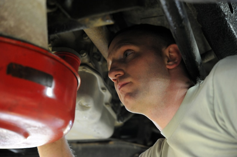 Tech Sgt. Kevin Pennington, 341st Logistics Readiness Squadron vehicle mechanic, changes his oil at the base auto hobby shop March 7. The auto shop offers a variety of tools for repairing a car. (U.S. Air Force photo/Airman 1st Class Joshua Smoot)