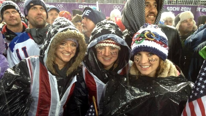 U.S. Air Force Capt. Christy Wise, left, Jessica Wise, middle, and Alexandra Wise, pose for a photo during the Olympics in Sochi, Russia, Feb. 18, 2014. The group improvised trash bags into ponchos to protect themselves from the rain while watching David Wise compete in Olympic freestyle halfpipe skiing. (Courtesy photo)