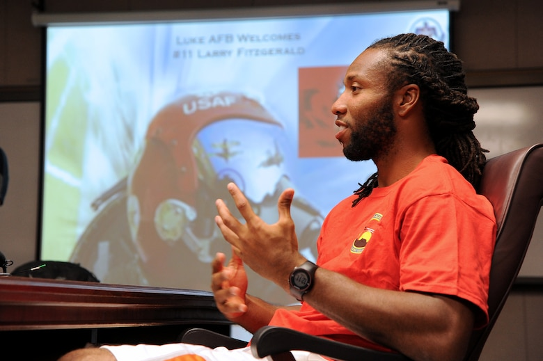 Larry Fitzgerald, Arizona Cardinals wide reciever, speaks to members of the media March 14 while waiting for his preflight briefing at Luke Air Force Base. Fitzgerald flew in U.S. Air Force Thunderbirds jet no. 8 in which he experienced all the aerial maneuvers that the Thunderbirds will be performing during Luke's Open House and Air Show on March 15 and 16. (U.S. Air Force photo by Airman 1st Class Pedro Mota)