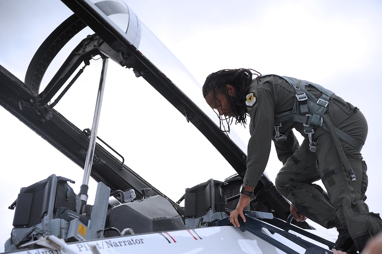 Arizona Cardinals wide reciever Larry Fitzgerald climbs into U.S. Air Force Thunderbirds jet no. 8 on March 14 at Luke Air Force Base prior to his flight in the jet. During the flight, Fitzgerald had the opportunity to experience every maneuver that will be performed during Luke's Open House and Air Show March 15 and 16 at Luke AFB, (U.S. Air Force photo by Airman 1st Class Pedro Mota)