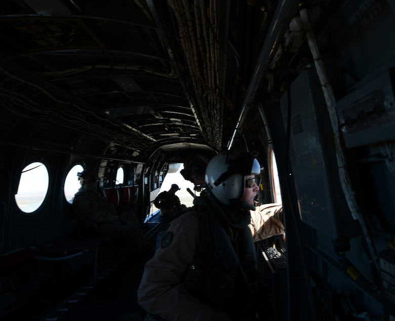 A Marine inside a CH-46 Sea Knight helicopter as it takes off March 13, 2014, from Mountain Home Air Force Base, Idaho. Marines from the 3rd Marine Aircraft Wing at Marine Corps Air Station Miramar, Calif., are currently at MHAFB participating in Gunfighter Flag.  The exercise is designed to prepare multiple joint and coalition terminal attack controller teams for upcoming deployments as well as provide proficiency training for aircrews. (U.S. Air Force photo by Senior Airman Benjamin Sutton/Released)