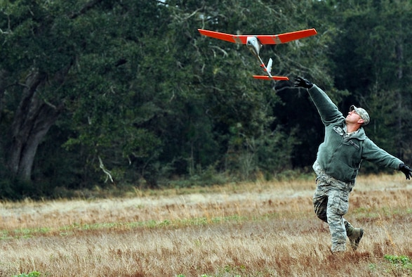 Senior Airman Andrew Goffeney, 1st Special Operations Security Forces Squadron combat arms journeyman, launches a RQ-11B Raven at Choctaw Field, Fla., March 4, 2014. Goffeney practiced launching the small unmanned aerial system, which requires a specific technique for takeoff. (U.S. Air Force photo/Senior Airman Michelle Patten)