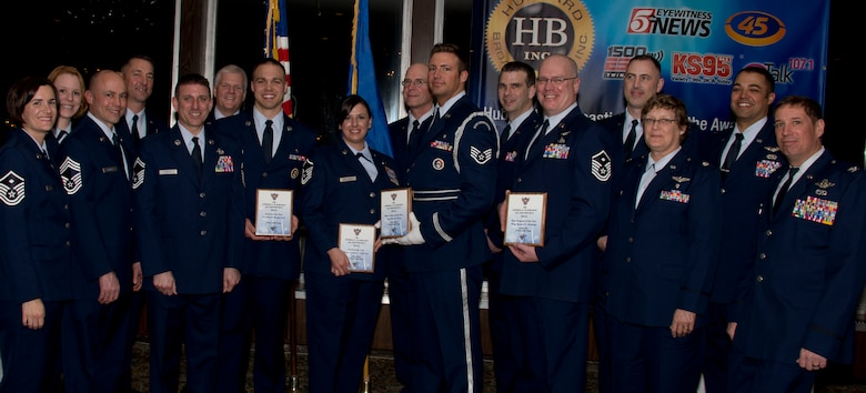 Members of the Minnesota Air National Guard pose for a photograph after the Air Force Association's (AFA) Annual Awards Dinner in St. Paul, Minn., Mar. 15, 2014. The AFA honored the 133rd Airlift Wing 2014 Outstanding Airmen of the Year for their achievements.