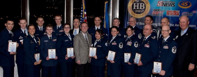 Retired U.S. Air Force Gen. Craig McKinley, President of the Air Force Association, upper right, pose for a group photograph in St. Paul, Minn., Mar. 15, 2014. The Air Force Association recognized men and women for their outstanding accomplishments. 