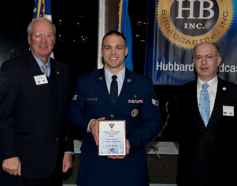 Senior Airman Hunter Heggerston, 133rd Medical Group, receives an award from Retired U.S. Air Force Gen. Craig McKinley, President of the Air Force Association, and Larry Sagstetter, Rawlings Chapter President in St. Paul, Minn., Mar. 15, 2014. Heggerston is being honored for being the 133rd Airlift Wing Airman of the Year during the Air Force Association's Annual Awards Dinner.