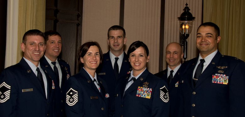 Airmen from the 133rd Maintenance Group and 109th Airlift Squadron pose for photograph with Master Sgt. Crystal Galloway, center right, in St. Paul, Minn. Mar. 15, 2014. Galloway is being honored for being the 133rd Airlift Wing Senior NCO of the Year during the Air Force Association's Annual Awards Dinner.