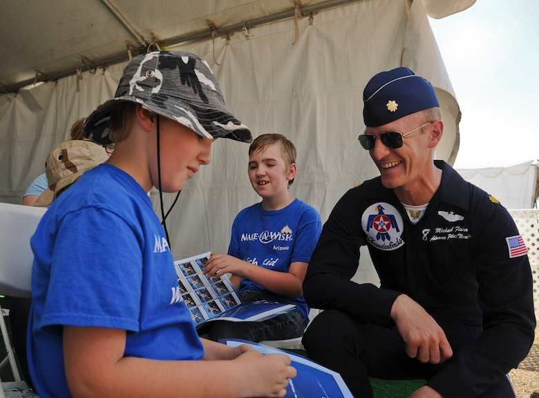 Maj. Michael Fisher, U.S. Air Force Demonstration Squadron advance pilot and narrator, meets with Samuel Schow after the Thunderbirds practice performance Mar. 14 at Luke Air Force Base. Samuel and his brother Aidan both suffer from a disorder called nemaline myopathy, requiring both to utilize feeding tubes. (U.S. Air Force Photo by Staff Sgt. Darlene Seltmann)