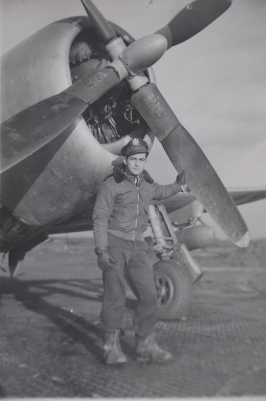Then 1st Lt. Kenneth Sadick, World War II P-47 Thunderbolt pilot, poses in front of his P-47 Thunderbolt in the November of 1947 in St. Tronde, Belgium, just a month before flying in the Battle of the Bulge. (Courtesy photo)