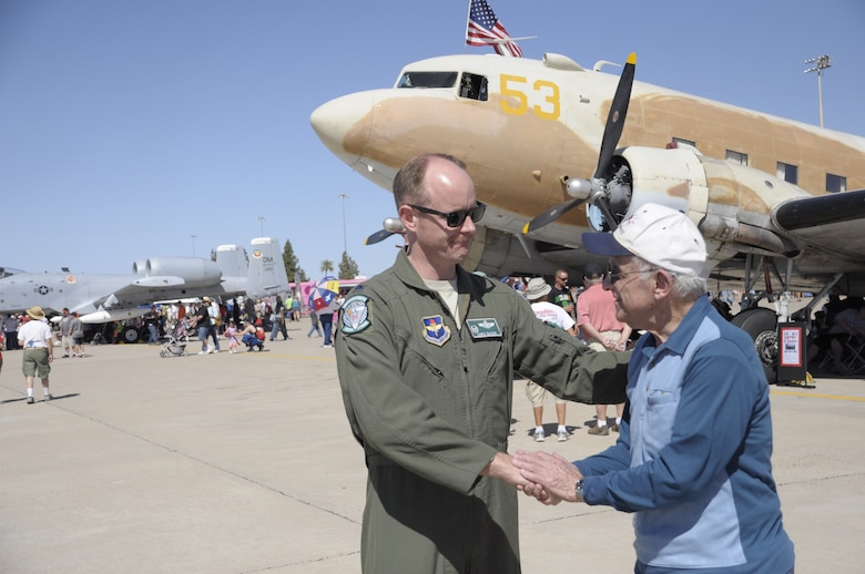 Lt. Col. Chris Bacon, 308th Fighter Squadron commander, coins 1st Lt. Ken Sadick, a World War II veteran, March 15 at Luke Air Force Base's Open House and Air Show. Sadick, 90 years old, graduated from Luke Field in March 1944, receiving his wings exactly 70 years ago this month. (U.S. Air Force photo by Staff Sgt. Timothy Boyer)