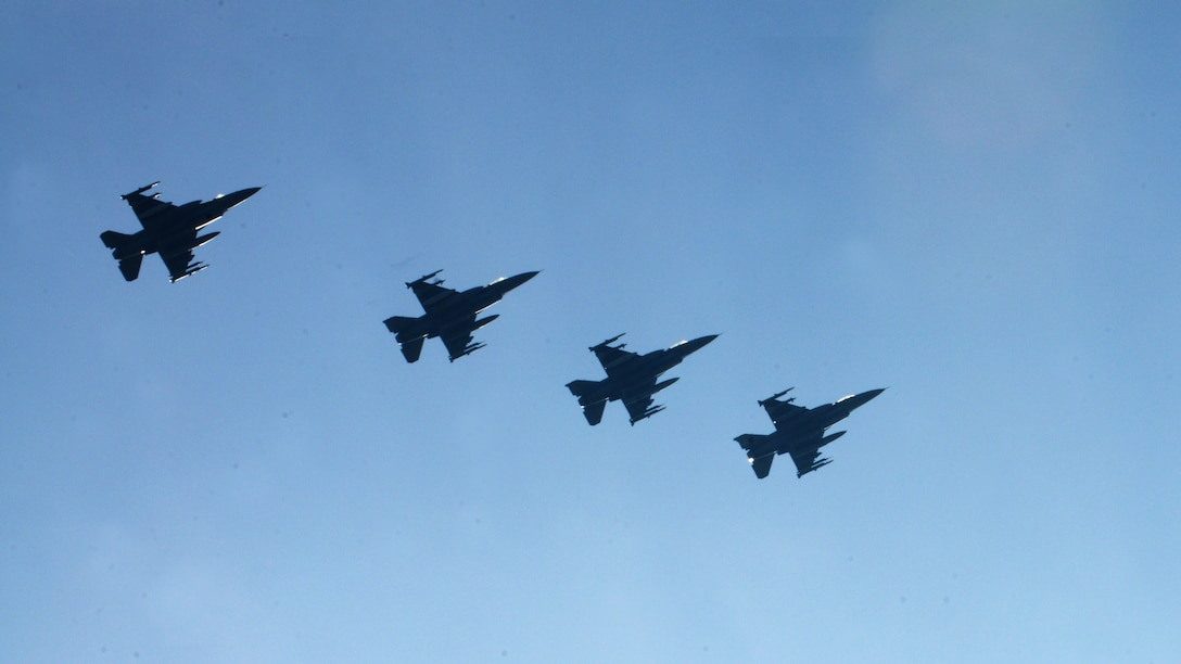 Four F-16 Fighting Falcons assigned to the 555th Fighter Squadron at Aviano Air Base, Italy, fly in formation prior to landing, March 14, 2014, at Lask Air Base, Poland. A total of twelve 555th Fighter Squadron F-16 Fighting Falcons and 200 military personnel arrived to augment an off-site training event, which demonstrates an enduring partnership with NATO allies. (U.S. Air Force photo/Airman 1st Class Ryan Conroy)