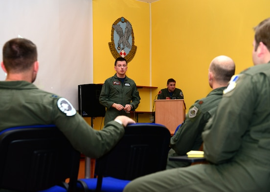 Polish air force Col. Nowak Ireneusz greets pilots assigned to the 555th Fighter Squadron at Aviano Air Base, Italy, alongside the Polish 32nd Tactical Squadron pilots March 14, 2014, during an initial meet and greet at Lask Air Base, Poland. NATO training fosters interoperability and enhances bilateral defense ties between the U.S. and their allies. Ireneusz is the 32nd Tactical Air Base commander. (U.S. Air Force photo/Airman 1st Class Ryan Conroy)