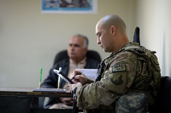 Senior Master Sgt. Carmelo Vega Martinez takes notes during a meeting with Afghan Air Force recruiters, Feb. 25, 2014, Kabul, Afghanistan. In support of Operation Enduring Freedom, Vega Martinez advises the Afghan Air Force on establishing and sustaining a recruiting service. Vega Martinez, a Ponce, Puerto Rico native, is deployed from the 368th Recruiting Squadron, Hill Air Force Base, Utah. Martinez is a 438th Air Expeditionary Wing/NATO Air Training Command-Afghanistan recruiting adviser. (U.S. Air Force photo/Tech. Sgt. Jason Robertson)
