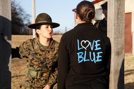 Sgt. Britni M. Garcia Green, a Platoon 4017, Company N, 4th Recruit Training Battaltion, Marine Corps Recruit Depot Parris Island drill instructor, instructs a female poolee to speak with intensity and volume during Recruiting Station Kansas City's all-female pool function outside 9th Marine Corps District's Building 712 March 15, 2014. The poolees were instructed on close-order drill, what to expect during recruit training, and hygiene and also performed a mock Inital Strength Test with consisted of the flexed-arm hang, crunches and 1.5-mile run. Poolees from all the Recruiting Sub-Stations in the RS were on-hand for the event.
