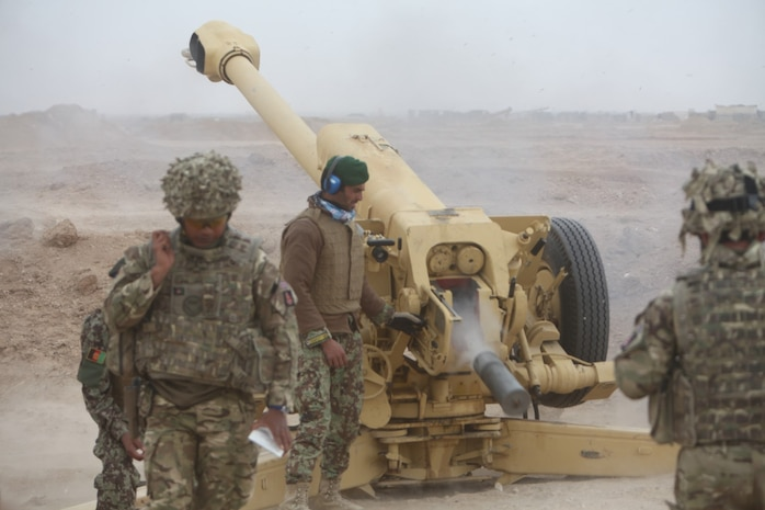 Afghan artillerymen with the 215th Corps, Afghan National Army, fire a D-30 122 mm howitzer during a live-fire exercise aboard Camp Shorabak, Helmand province, Afghanistan, March 12, 2014. The exercise was the culminating event of the six-week D-30 instructor course, which proved the Afghan soldiers ability to instruct future artillerymen in map plotting and firing of the D-30. (U.S. Marine Corps photo by Cpl. Joshua Young)