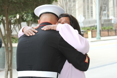 Tracey McGinnis hugs Sgt. Matthew Sullivan upon meeting him outside Grady Memorial Hospital in Atlanta, March 15. Sullivan, a native of Lawrenceville, GA, was the first responder at the scene of an accident involving Tracey's son Taray. Sullivan assisted Taray after his truck caught fire on I-85N at Old Peachtree Road, March 9. Sullivan is a recruiter with Recruiting Sub-Station Buford, Recruiting Station Atlanta. (U.S. Marine Corps photo by Sgt. Courtney G. White/released)
