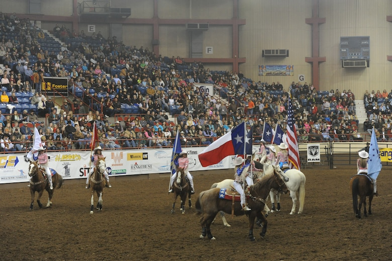 SAN ANGELO, Texas --The San Angelo Stock Show and Rodeo Drill Team Ambassadors present the American and service flags during the San Angelo Stock Show and Rodeo's Military Appreciation Night at the Foster Communication Coliseum here Feb. 26. Goodfellow Air Force Base's Patriotic Blue sang the national anthem during the flag presentation. (U.S. Air Force photo/ Staff Sgt. Laura R. McFarlane)