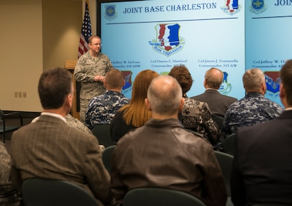 Col. Jeffrey DeVore, Joint Base Charleston commander, speaks to the Honorary Commanders March 13, 2014, during their orientation tour of JB Charleston-Air Base, S.C. The Joint Base Charleston Honorary Commanders Program encourages an exchange of ideas, experiences, and friendship between key members of the local civilian community and the Charleston military community.  The program provides a unique opportunity for members of the Charleston area to shadow commanders of Air Force wings and groups, as well as Navy and tenant units at Joint Base Charleston. (U.S. Air Force photo/Senior Airman Ashlee Galloway)