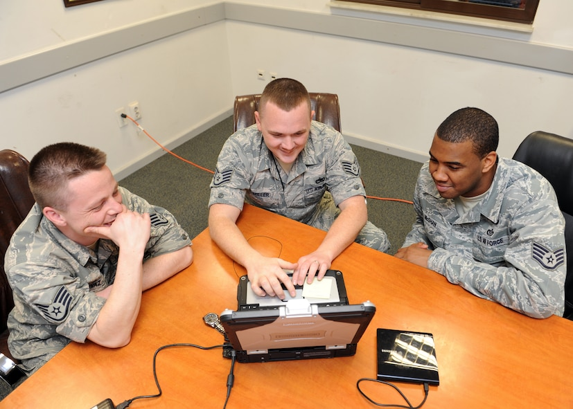 Staff Sgt. Chris Davaz, 39th Maintenance Squadron weapons flight inspector, Staff Sgt. Justin Miller, 39th MXS mission support flight inspector, and Christopher McShan II, 39th Civil Engineer Squadron readiness and emergency management flight technical order distribution office, review technical orders March 5, 2014, Incirlik Air Base, Turkey. The 39th MXS coordinates with many other agencies to do the right thing, at the right time. (U.S. Air Force photo by Senior Airman Chase Hedrick/Released)