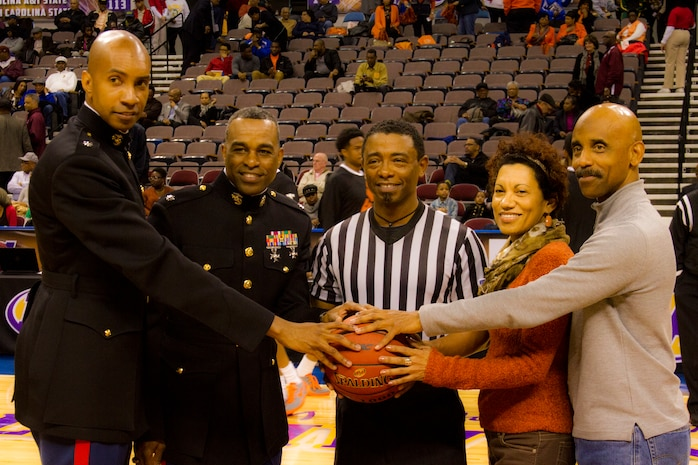 Lt. Col. Larry Parker (Left) and Lt. Col. David Rodgers (Right) pose with a ref  for the Hoops for Troops event during the 2014 Mid-Eastern Athletic Conference Basketball Tournament March 13. The Marine Corps is committed to making concerted efforts to attract, mentor, and retain the most talented men and women who bring a diversity of background, culture and skill in service to our nation.