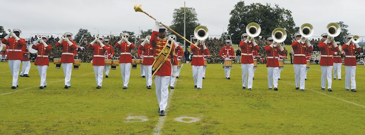 """In spite of Monday's rainy conditions, roughly 2,200 spectators from the local and surrounding communities watched the Marine Corps Silent Drill Platoon's, the Marine Corps Color Guard's and """"The Commandant's Own"""" Marine Corps Drum and Bugle Corps' dazzling performances at the Battle Color Detachment Ceremony at Marine Corps Logistics Base Albany.  The event showcased the Marine Corps as well as allowed it to show its appreciation to the community, according to Col. Don Davis, commanding officer, MCLB Albany.  """"This is a great opportunity for our Marines to see some of their own they have never seen before and it is also a great opportunity to show our appreciation to Albany,"""" Davis said."""