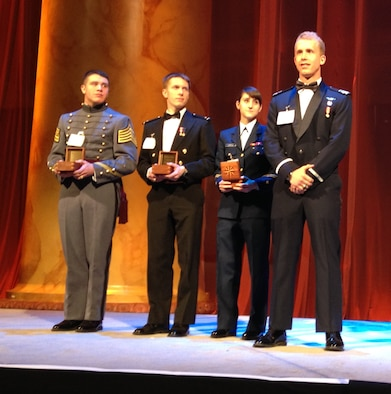 Cadet 1st Class Christopher Shannon (right) receives the 2014 Tomorrow's Leaders Award during the 57th Annual Laureates Awards March 6 in Washington, D.C. Shannon is the Academy Aeronautics Department's top cadet; he holds a 3.98 grade point average and is in the top 1 percent on the 2014 graduating class. (Air Force courtesy photo)