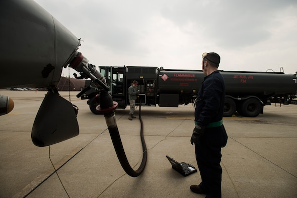 Airman 1st Class Kesten Accomando, a 25th Fighter Squadron crew chief, and Airman 1st Class Robert Youngs, a 51st Logistic Readiness Squadron fuels operator, track the refueling process on an A-10 March 18, 2014, at Osan Air Base, Republic of Korea. Kesten, Youngs refuel aircraft everyday as part of their duties. (U.S. Air Force photo by Staff Sgt. Jake Barreiro)
