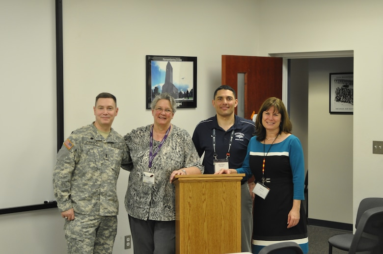 (Left to right) Nev. Army National Guard 1st Lt. Chaplain Candidate Robert Dawson, Ms. Janett Massolo, Nev. Army National Guard Capt. Mike Bordallo, and Ms. Misty Allen take a break from conducting ASIST training at the 152nd Airlift Wing, Reno, Nev. on Thursday, 13 February.  ASIST training is offered quarterly to northern and southern Nevada locations.  (Photo by Master Sgt. Paula Macomber, 152nd Airlift Wing Public Affairs. RELEASED)