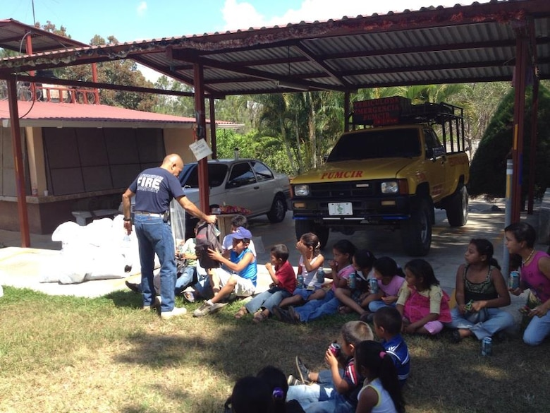 Children from the village of Mata de Patano, just outside of Comayagua, Honduras, receive clothes and backpacks that were donated by the 612th Air Base Squadron fire department, Joint Task Force-Bravo, clothes drive March 8, 2014.  The drive collected more than 275 sets of clothing and shoes that helped over 30 families.  (Courtesy photo)