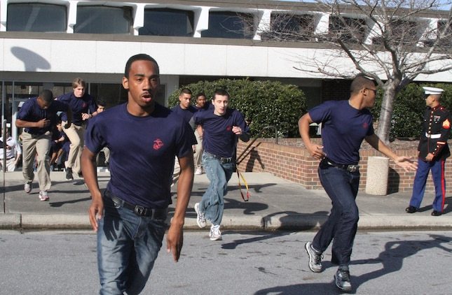 Poolees from Recruiting Sub-Station Greenville run to get into formation during a family night at the East Carolina University Willis Buildings in Greenville, N.C., March 8, 2014. Family nights are a time for the families of the applicants to come together, meet the Marines of the Sub-Station, learn about the Marine Corps and the process of boot camp.