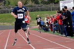 COLORADO SPRINGS, Colo. (May 17, 2011) Team Navy/Coast Guard member Lt. Daniel B. Cnossen runs the 800-meter during the second annual Warrior Games. The Warrior Games is a Paralympic-style sport event among 200 seriously wounded, ill, and injured service members from the U.S. Army, Navy, Air Force, Marine Corps, and Coast Guard. (U.S. Navy photo by Mass Communication Specialist 1st Class Andre N. McIntyre/Released)