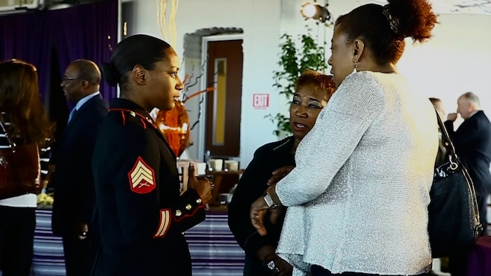 U.S. Marine Corps Sergeant Wyanika Christophe, career planner, 4th Assault Amphibian Battalion, speaks with key personnel from the Mid-Eastern Athletic Conference during the Norfolk Mayoral Reception at the Wells Fargo Center, Norfolk, Va., March 13, 2014. The MEAC partnership provides the Marine Corps with an opportunity to celebrate the hard work, courage, and commitment to excellence exhibited by its many participants. (U.S. Marine Corps photo by Lance Cpl. Francisco Martinez/Released)