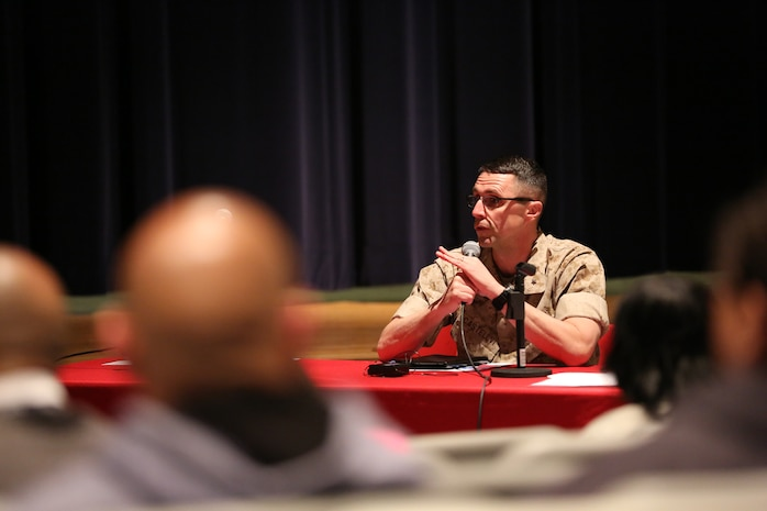 Brig. Gen. Robert Castellvi, commanding general of Marine Corps Base Camp Lejeune, addresses parents, teachers and students at a town hall meeting aboard Marine Corps Base Camp Lejeune, March 13. Members of the the community gathered at the Lejeune High school auditorium to ensure their voices were heard during the meeting. Topics included the proposed school dress code and the common core state standards.
