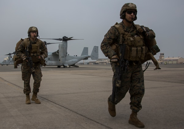 Marines with the 31st Marine Expeditionary Force exit the MV-22 Osprey and begin a noncombatant evacuation operation aboard Marine Corps Air Station Iwakuni, Japan, March 19, 2014. The Osprey aircraft allows the MEU to reach greater distances at a faster speed than ever before.