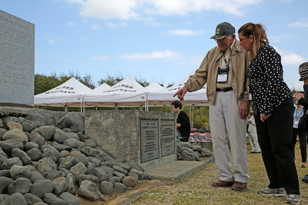 U.S. Army veteran Edward Mervich, left, tells Anne Swenson about his experiences fighting in the Battle of Iwo Jima March 19 during the annual Reunion of Honor ceremony. This year's ceremony commemorated the 69th anniversary of the battle on Iwo To, formerly known as Iwo Jima, Japan. On the ground where one of the most brutal battles of World War II took place, Japanese and U.S. allies came together to honor and remember the sacrifices of the gallant men who fought for their countries more than 69 years ago.