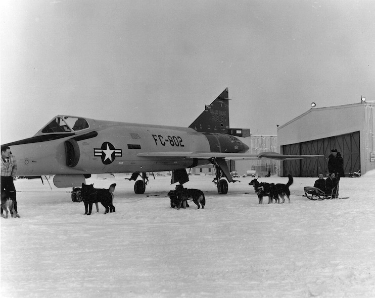 A team of sled dogs stand beside a Convair F-106 Delta Dart circa 1960 at Ladd Air Force Base, Alaska. (Photo courtesy of Fort Wainwright archives)