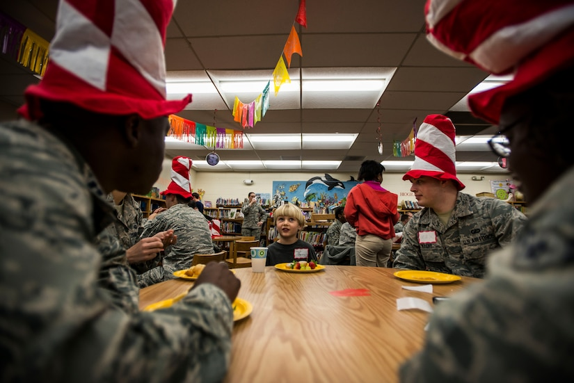Hoyt Darden, a St. Andrews Elementary School kindergarten student, eats breakfast with a group of Airmen from Joint Base Charleston, S.C., before the Airmen read their favorite Dr. Seuss books to the students March 7, 2014. More than 30 Airmen from JB Charleston attended the event, ate breakfast with the children and answered questions about the Air Force. (U.S. Air Force photo/ Senior Airman Dennis Sloan)
