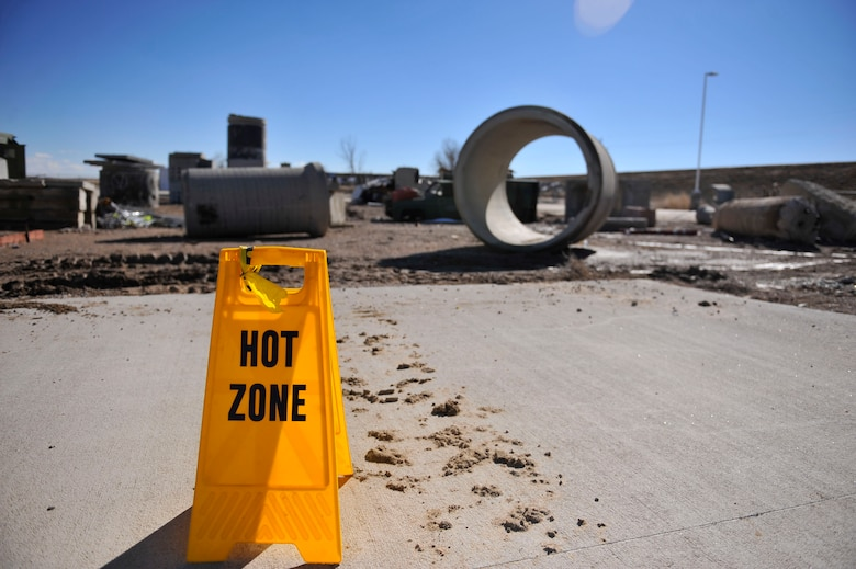 """A sign depicts a large area of rubble, known as the """"hot zone"""", where Colorado National Guard Chemical, Biological, Radiological, Nuclear and High-Yield Explosive Enhanced Response Force Package members practice an emergency exercise March 8, 2014, in Lakewood, Colo. The CERFP team spends one weekend every three months training in an emergency exercise to refine their skills in search and rescue, decontamination and medical procedures. (U.S Air Force photo by Airman 1st Class Samantha Saulsbury/Released)"""