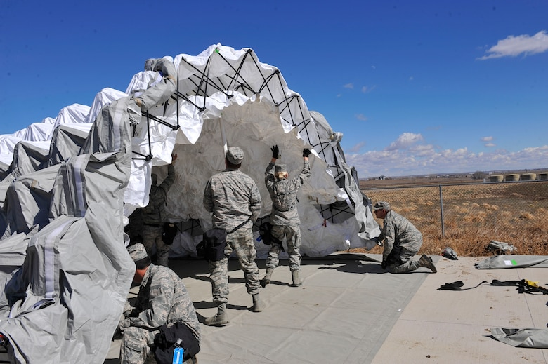 Colorado Air National Guard 140th Medical Group members assemble a medical tent during Colorado National Guard Chemical, Biological, Radiological, Nuclear and High-Yield Explosive Enhanced Response Force Package exercise March 8, 2014, in Lakewood, Colo. The CERFP team spends one weekend every three months training in an emergency exercise to refine their skills in search and rescue, decontamination and medical procedures. (U.S Air Force photo by Airman 1st Class Samantha Saulsbury/Released)