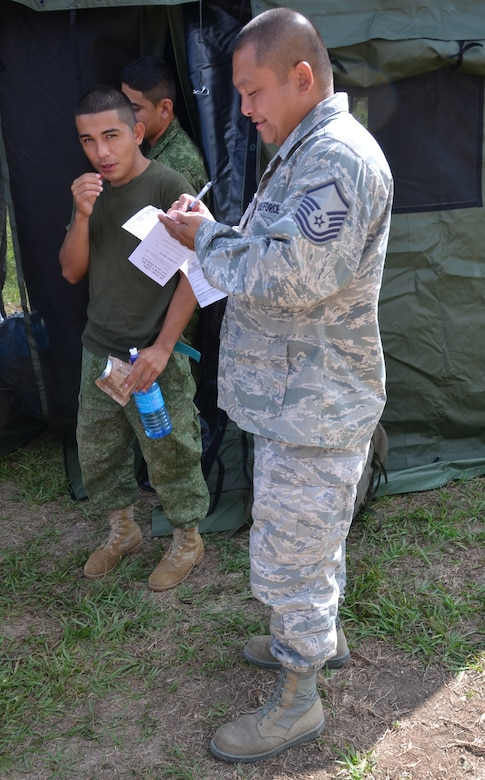 Master Sgt. Enrique Naranjo, New Horizons logistics superintendent, prepares a MRE hand receipt for the Belize Defence Force soldiers securing New Horizons equipment at the Belmopan Hospital construction site, March 11. During the past 20 years, U.S. Southern Command has worked side-by-side with the Belize Defence Force as well as the Ministries of Health and Education to conduct combined exercises to strengthen each participant's response to humanitarian relief scenarios. (USAF photo by Master Sgt. Kelly Ogden/Released)