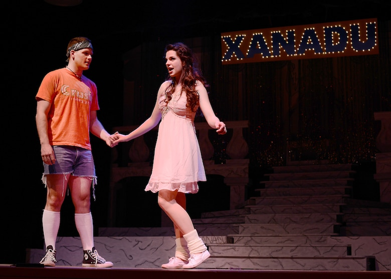 """Airman 1st Class Joshua Blackburn, Detachment 8 American Forces Network broadcast journalist, and Annalisa Hardin, Aviano High School junior, perform a duet as Sonny Malone and Kira in the Aviano Community Theater performance, """"Xanadu,"""" March 15, 2014, at Aviano Air Base, Italy.  The Aviano Community Theater cast included more than 50 Team Aviano members. (U.S. Air Force photo/Airman 1st Class Deana Heitzman)"""