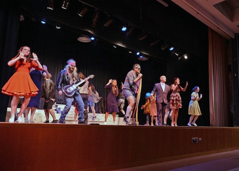 """The cast of the Aviano Community Theater performance, """"Xanadu,"""" dance during an act, March 15, 2014, at Aviano Air Base, Italy. """"Xanadu"""" is an '80s love story between an uninspired artist and a Greek muse who helps him fulfill a lifelong dream of opening a roller disco. (U.S. Air Force photo/Airman 1st Class Deana Heitzman)"""