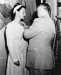 Virginia Hall receiving the Distinguished Service Cross in 1945 from OSS chief General Donovan.