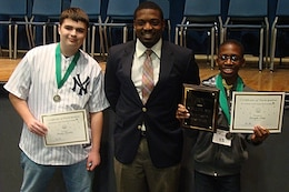 Joseph Ebai, the son of a Charleston District economist in the planning branch, won the Berkeley County Spelling Bee.