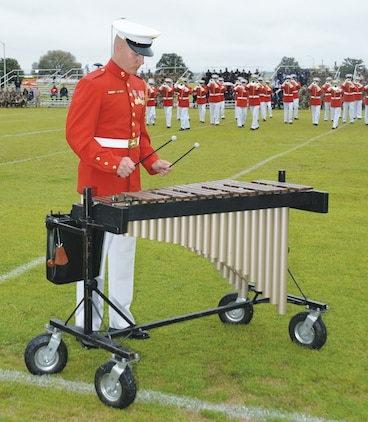 """A Marine Drum and Bugle Corps xylophone player entertains onlookers during """"Music In Motion"""" at Monday's Battle Colors Ceremony held at Schmid Field, aboard Marine Corps Logistics Base Albany."""