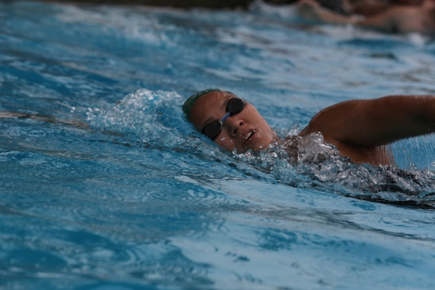 First Lt. Thuymi Dinh, communications officer, 1st Battalion, 11th Marine Regiment, swims laps as part of her training for triathlons at Camp Las Pulgas, Marine Corps Base Camp Pendleton, Calif., March 13, 2014. Dinh, a native of Anaheim, Calif., is being recognized as Camp Pendleton's Female Athlete of the Year. Dinh has competed in approximately 12 triathlons and hopes to one day compete in an Ironman Triathlon.