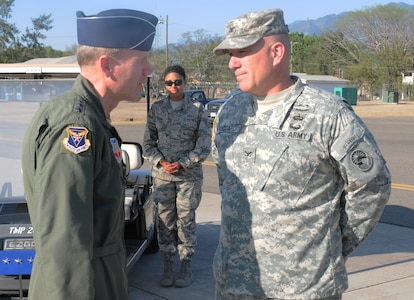 U. S. Army Col. Thomas Boccardi, Joint Task Force-Bravo commander, welcomes U. S. Air Force Lt. Gen. Tod Wolters, 12th Air Force commander, to Soto Cano Air Base, Honduras March 19, 2014. Wolters traveled to Honduras to learn more about the many missions that JTF-Bravo performs in Central America.  (Photo by U. S. Air National Guard Capt. Steven Stubbs)